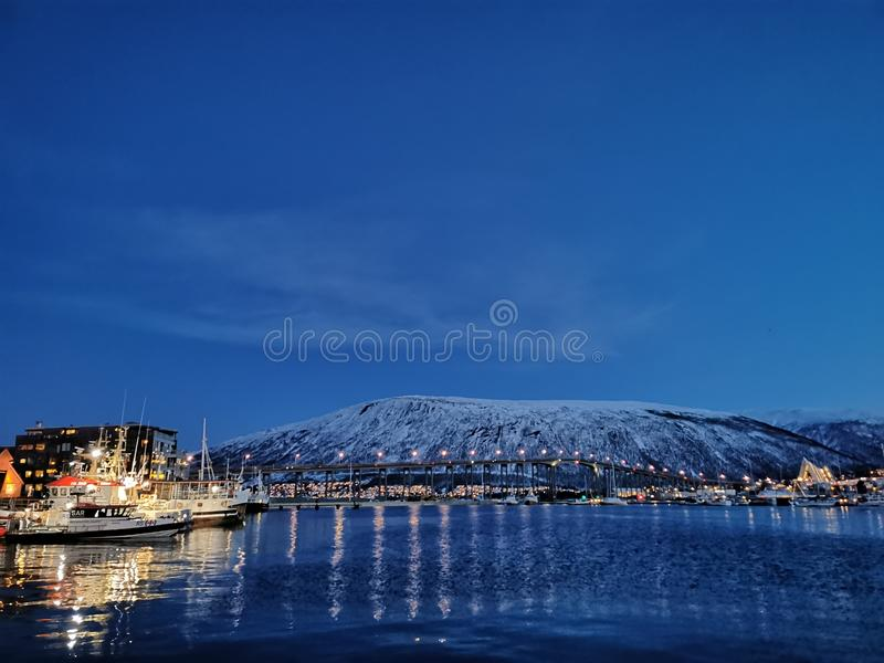 Old port sailing boat at Tromso Norway royalty free stock images