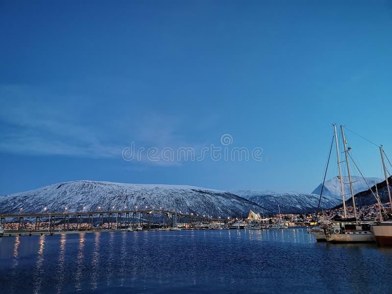 Old port sailing boat at Tromso Norway royalty free stock photo