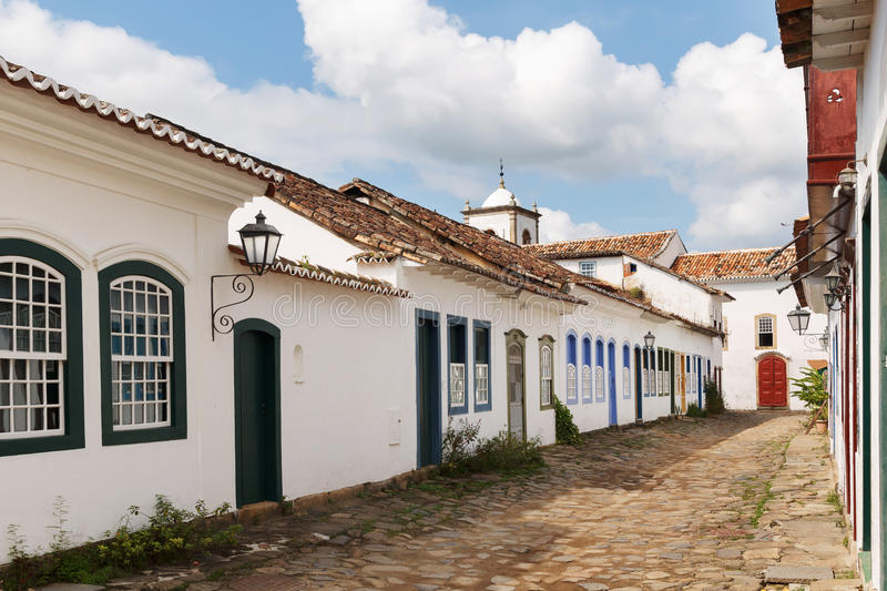 Old portuguese colonial houses and church in historic downtown o. Street, old portuguese colonial houses with lanterns and church in historic downtown of Paraty stock photos