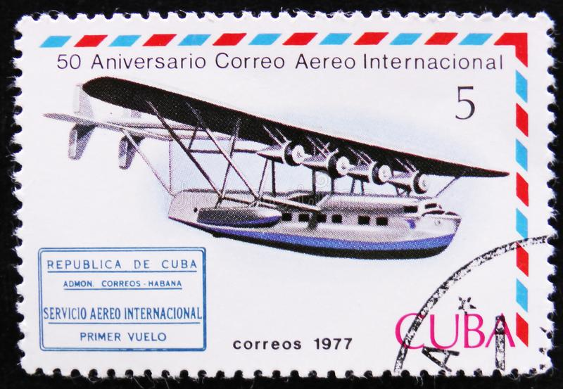 Old post stamp, series International Airmail Service, 50th Anniversary, circa 1977. MOSCOW, RUSSIA - APRIL 2, 2017: A stamp printed in Cuba shows Airplane and royalty free stock images