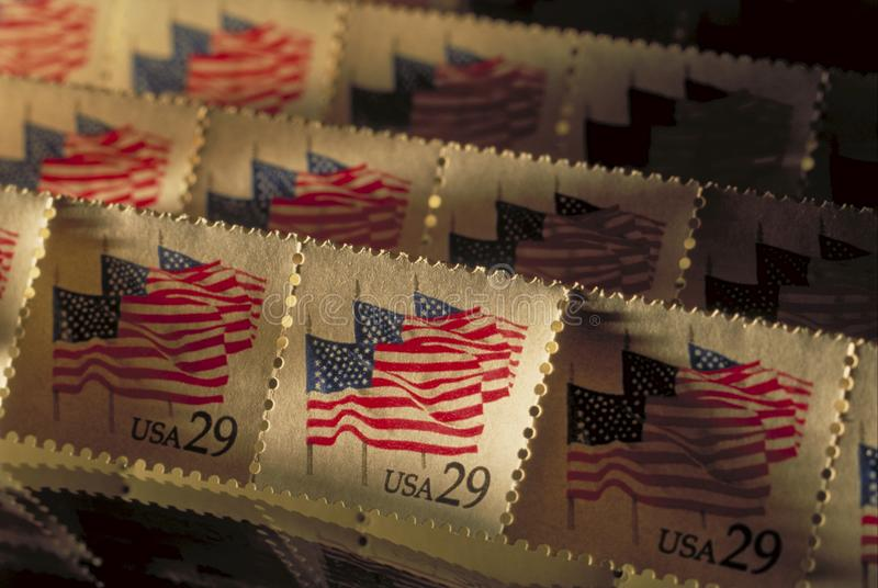 Old postage stamps raked in sunlight royalty free stock photography