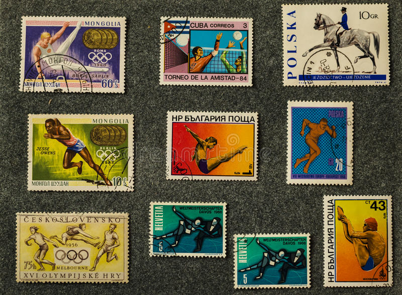 Old postage stamps from various countries, sports subjects royalty free stock images