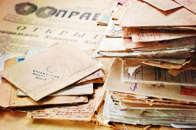 Old postal letters on the old newspaper royalty free stock image