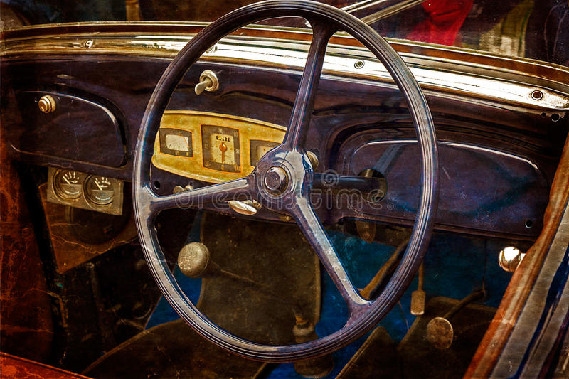 Old postcard with driver's cockpit of a vintage classic car 5 royalty free stock images