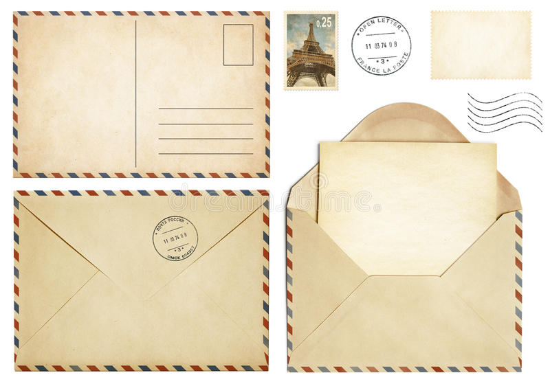 Old postcard, mail envelope, open letter, stamp collection. Isolated on white stock image
