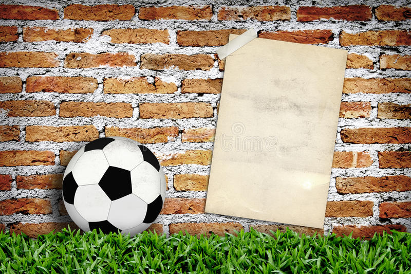 Old poster and football. In vintage area stock images