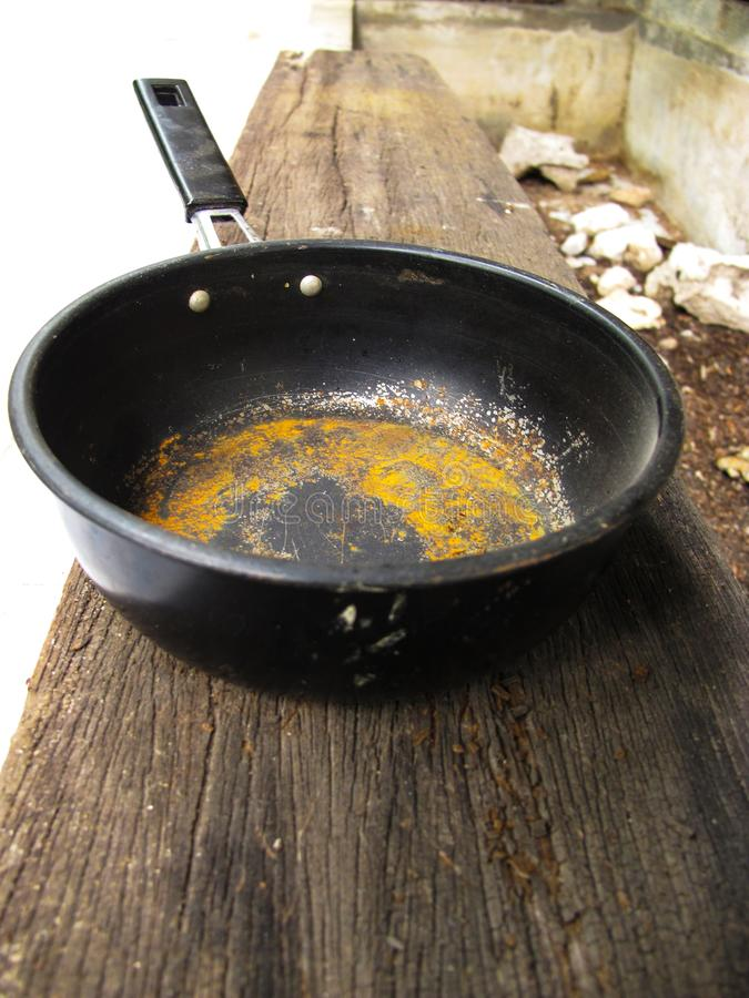 Old Pot of rust with handle royalty free stock photography