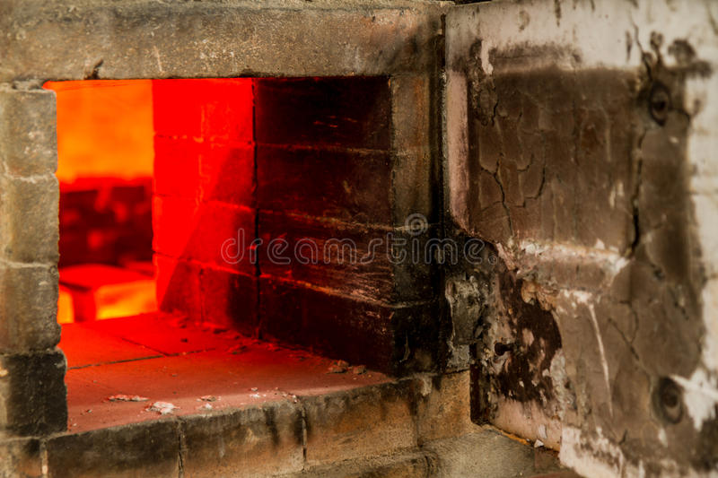 Old Pottery Kiln Firing. Ceramic Pottery Kiln Firing with cermaics inside royalty free stock image