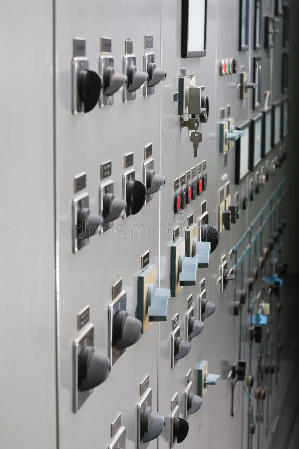 Old power plant control panel with switches and instruments. Power plant control panel with switches and instruments stock image