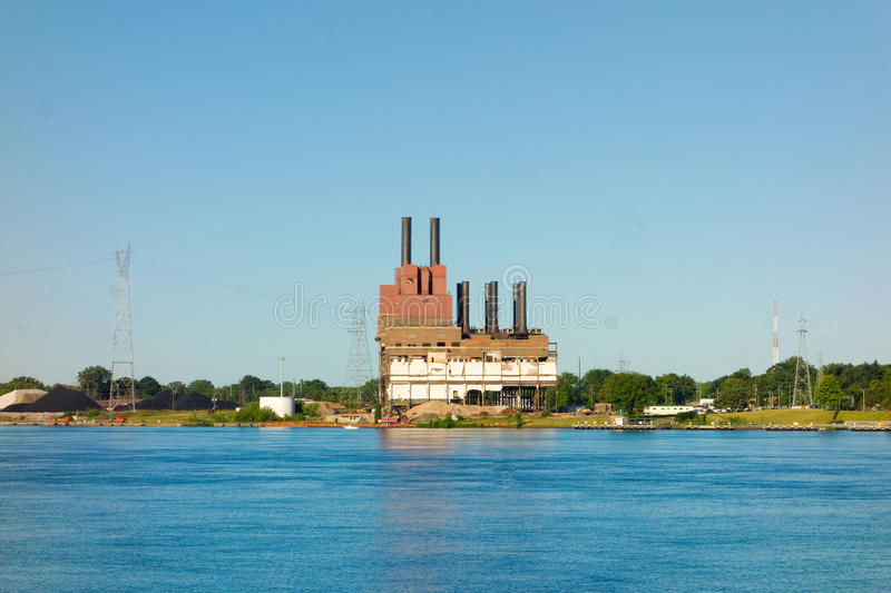 An old power plant on lake superior royalty free stock images