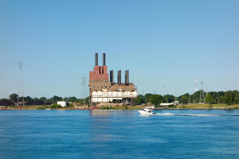 An old power plant on lake superior stock images