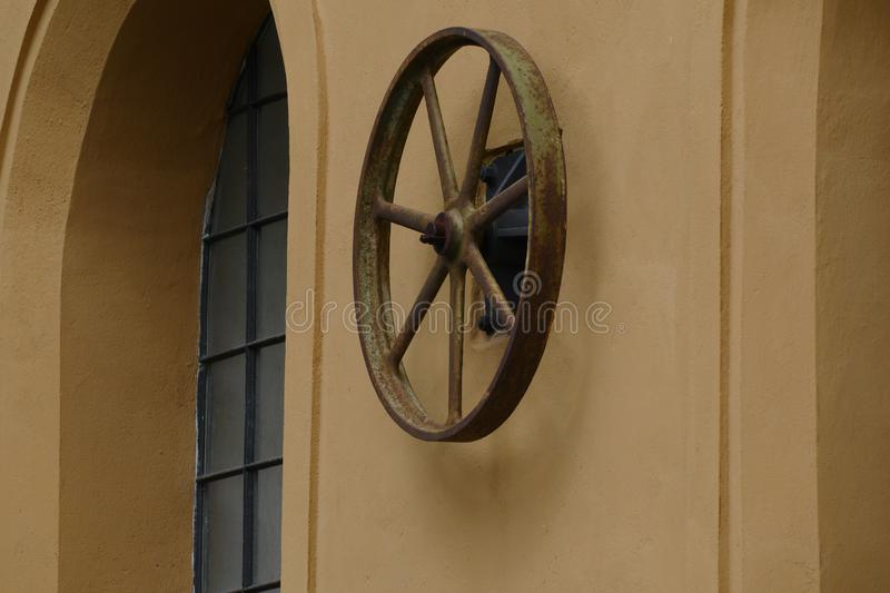 Old powerplant pulley stock photo
