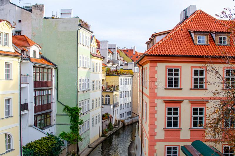 Old Prague street on the Vltava river, view from Charles Bridge.  royalty free stock image
