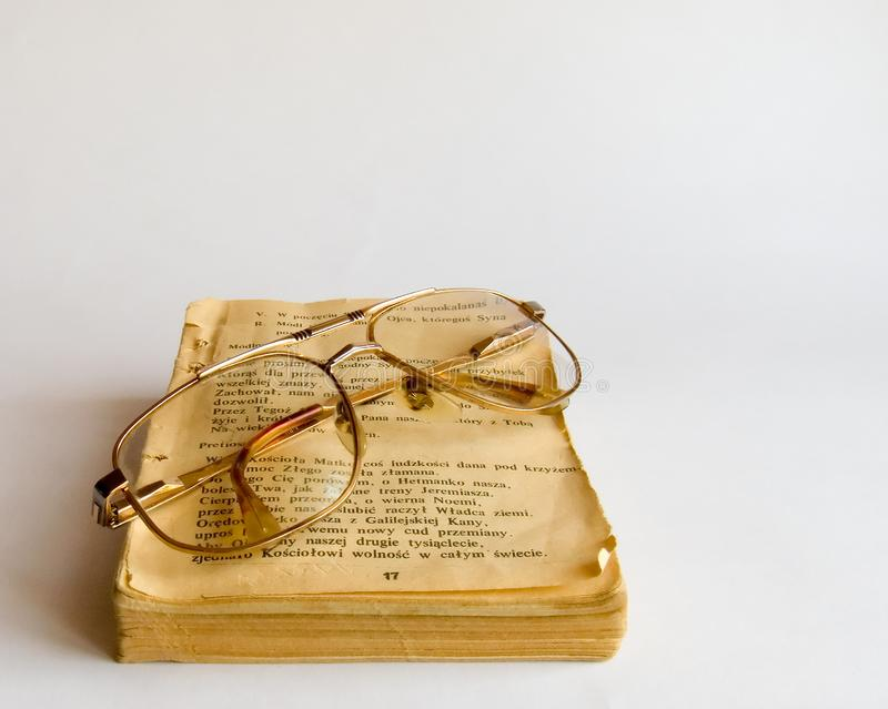 Old prayer book and glasses stock photo