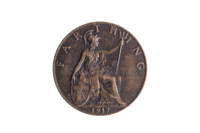 Old pre decimal 1917 George V farthing coin of England UK reverse Britannia. Cut out and isolated on a white background royalty free stock photo