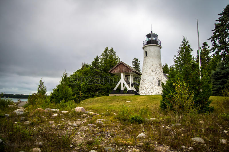 Old Presque Isle Lighthouse. The old Presque Isle Lighthouse on the remote shores of Lake Huron. The lighthouse is supposedly haunted by a prior lightkeeper and stock photography