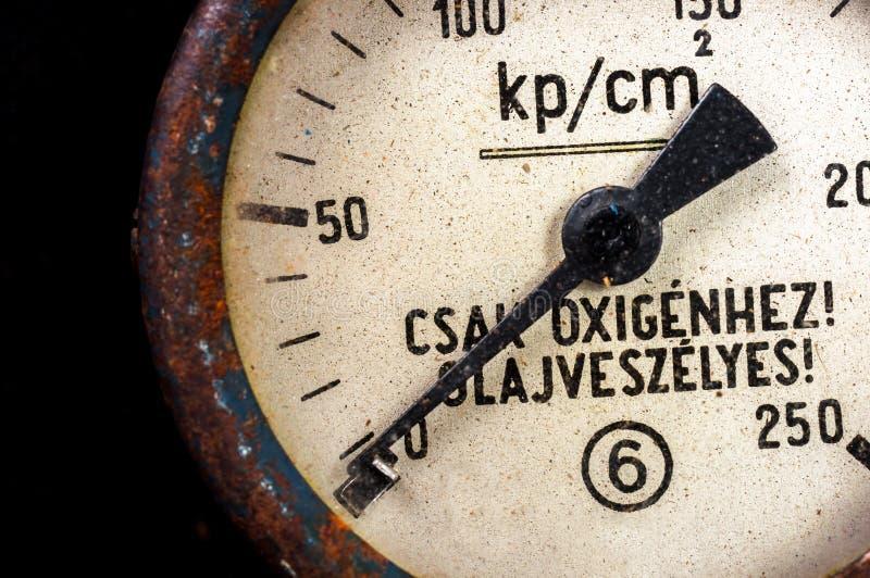 Old pressure gauge. On black background royalty free stock image