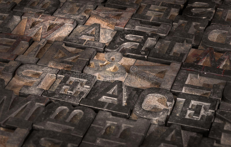 Old Printer Letters Spell out War & Peace - Slanted. In sepia tones stock image