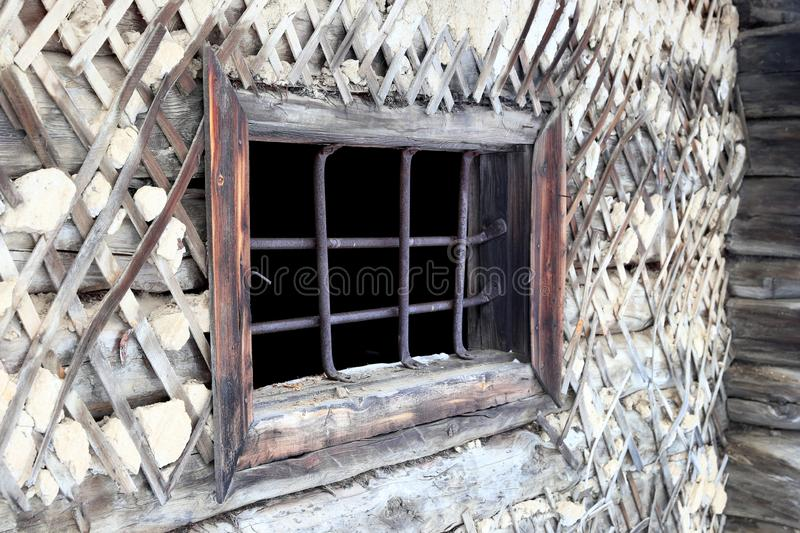 Grid on the window of an abandoned Soviet prison in the winter i. The old prison barracks of Stalin`s 501-construction sites of the GULAG. The construction of stock photo