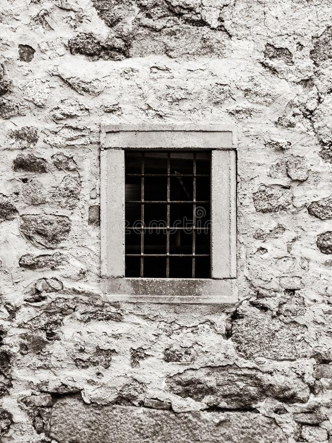 Old prison jail window with rusty metal bars. Vintage style image royalty free stock image
