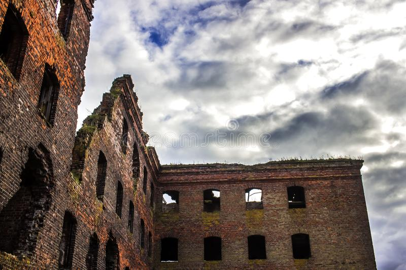 An old prison, 300 years old. Remains of the destroyed building of red brick. royalty free stock images