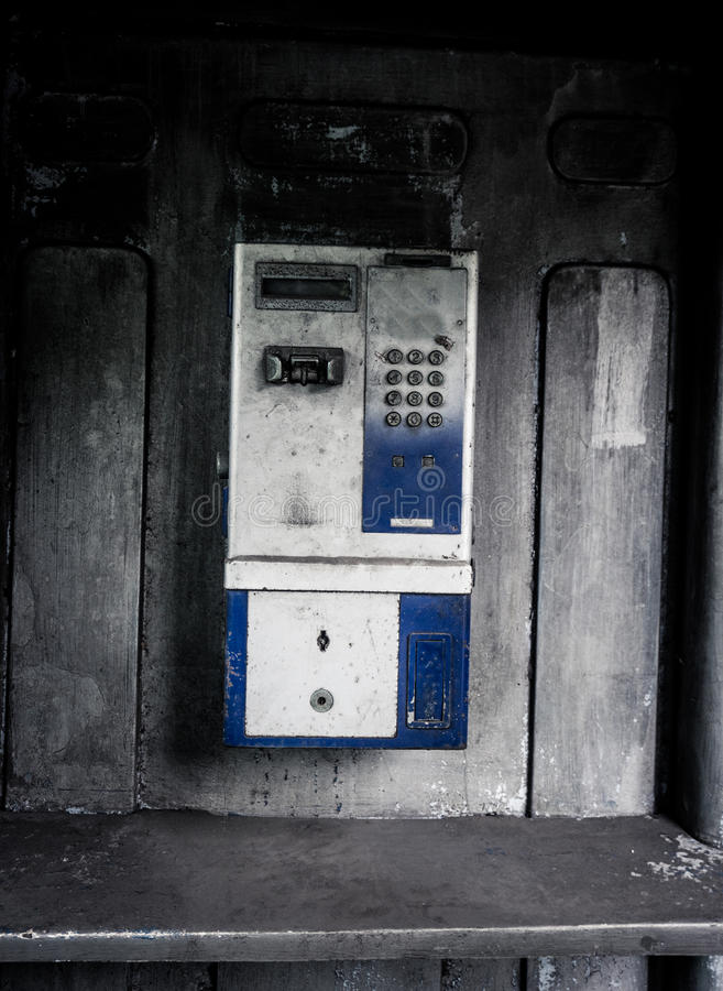 Old public telephone machine left with grunge photography style effect photo taken in Jakarta Indonesia. Java royalty free stock images