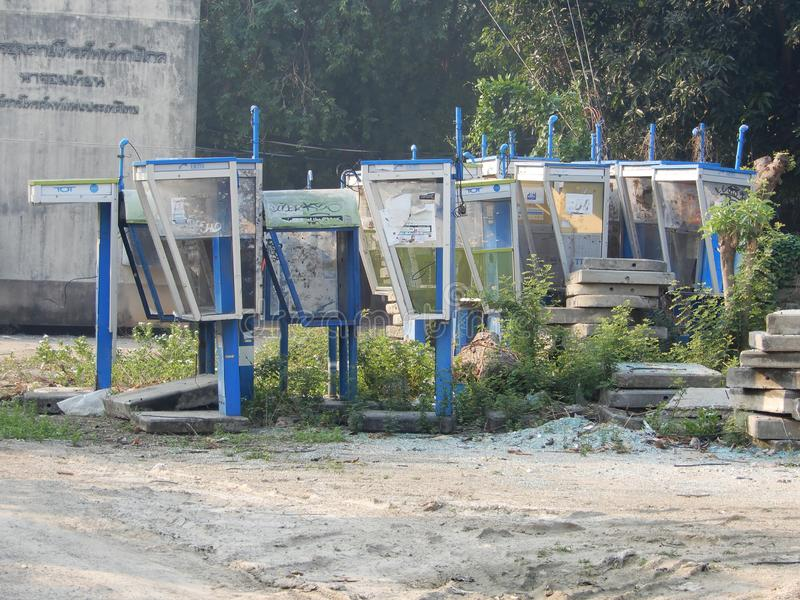 Old public telephones. Removed from service and dumped in this undeveloped plot, Jomtien, Thailand royalty free stock photos