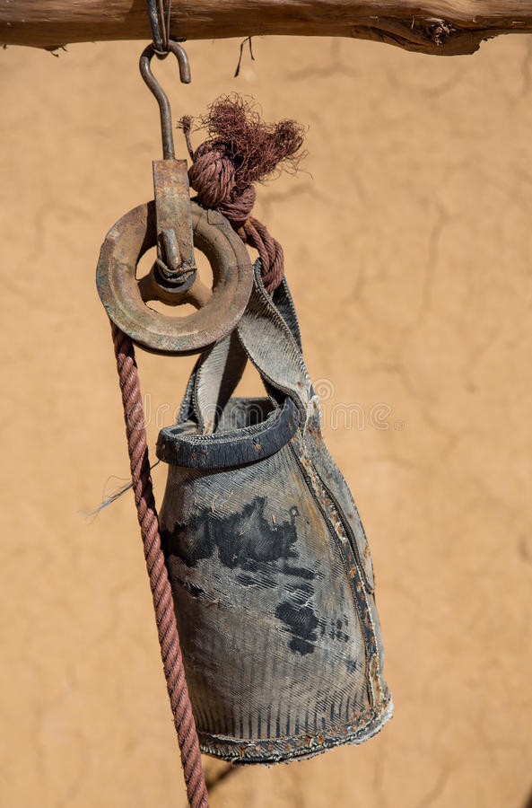 Closeup Of Old Pulley And Bucket With Shallow Depth Of Field