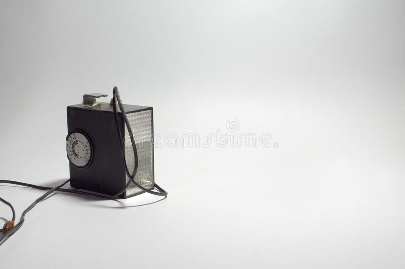 Vintage electronic pulse camera flash with hot shoe stock photo