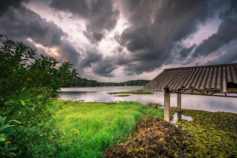 Old pump house and dramatic sky at Cheloor lake is, Sasthamcotta stock photos
