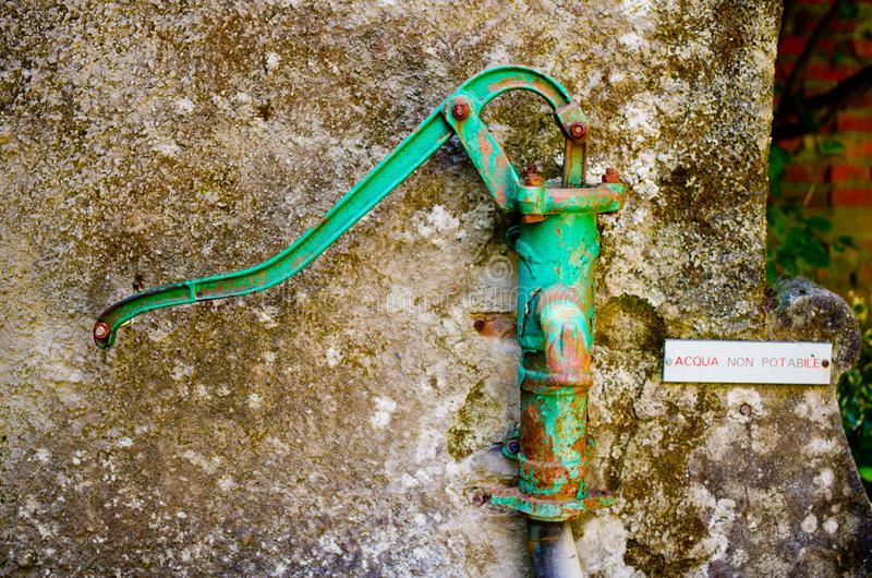 Old pump non-potable water. Rusty old pump non-potable water of an ancient village royalty free stock images