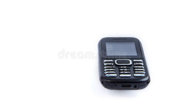 Old push button cell phone. On white background royalty free stock images