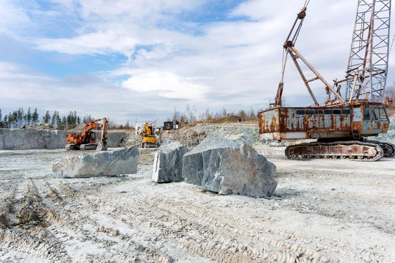 Old marble quarry with heavy machinery royalty free stock images