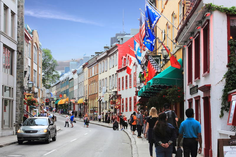 OLD QUEBEC HISTORIC STREET SHOPPING. QUEBEC, CANADA - AUG 12, 2015 On this historic old street in Quebec we see many shoppers and tourists checking out the royalty free stock photography