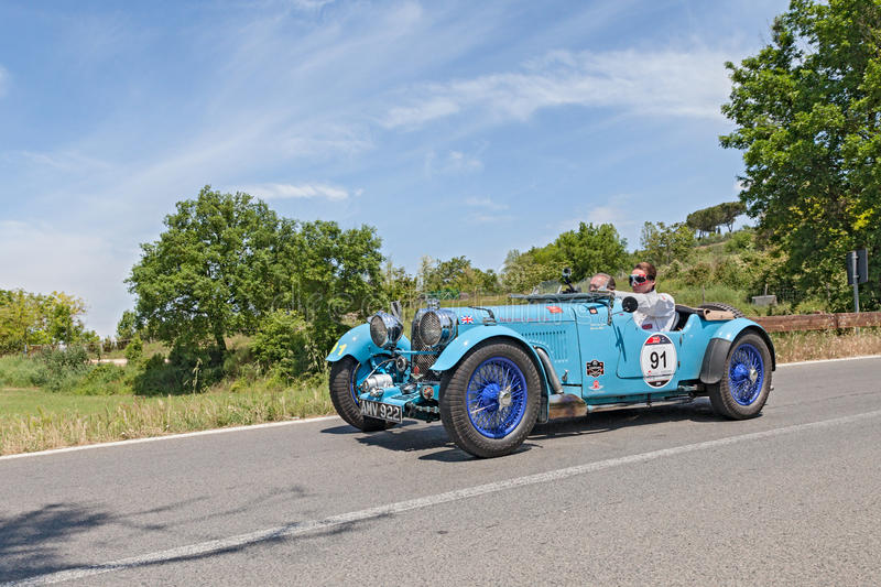 Old racing car Aston Martin Le Mans in Mille Miglia 2014. The crew Jan and Karel Ten Cate on a vintage racing car Aston Martin Le Mans (1933) runs in historical royalty free stock photography