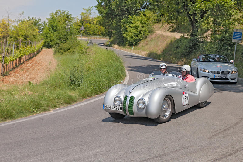 Old racing car BMW BMW 328 roadster (1939). The crew Robertson - Berry on a vintage racing car BMW 328 roadster (1939) travel in historical italian race Mille royalty free stock photos