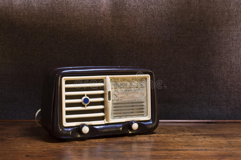 Old radio. An old and isolated radio on a vintage background