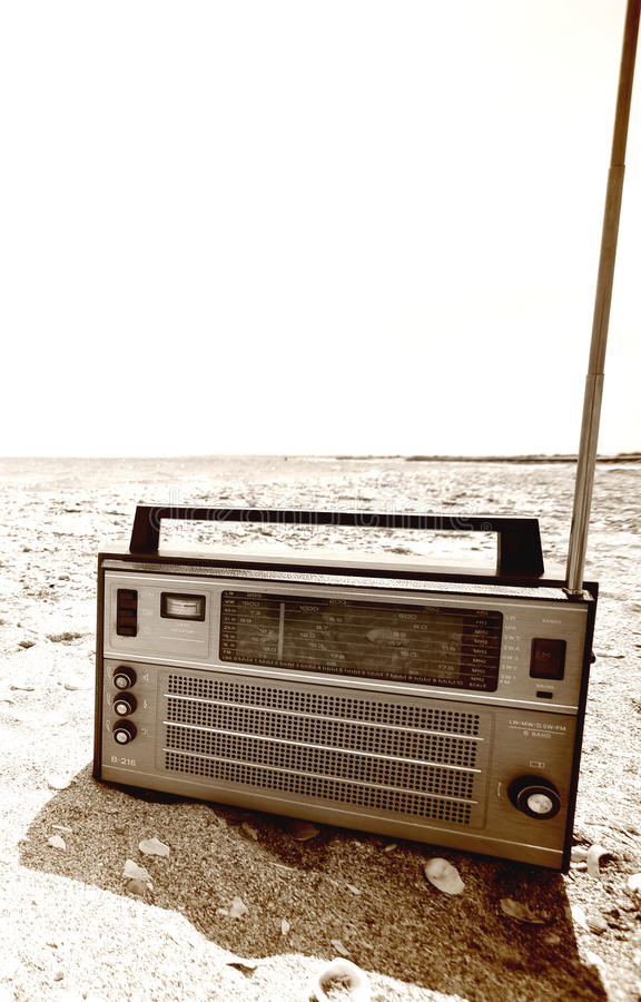 Old radio. On the beach - copy space royalty free stock image