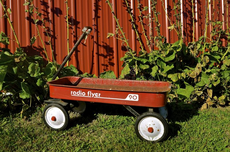 Old Radio Flyer wagon. EAST GRAND FORKS, MINNESOTA, Aug 5, 2016 The wagon is a Radio Flyer product which also makes tricycles, bicycles, and ride-ons and is base stock photo