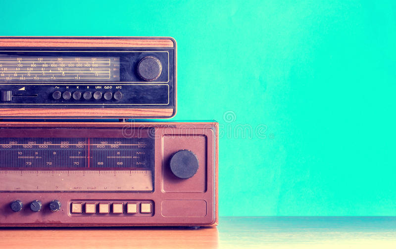 Old radios on blue background. Filtered photo stock photo