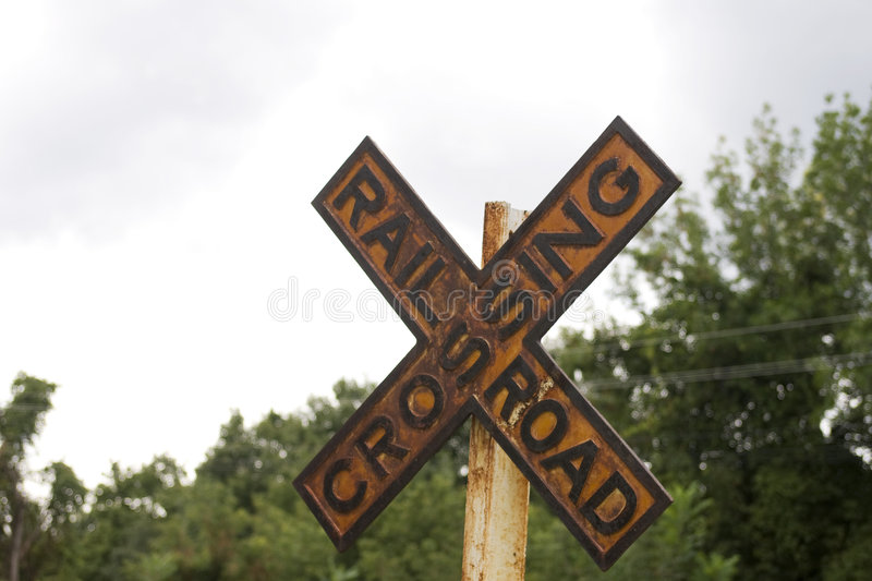 Old railroad crossing sign stock photo