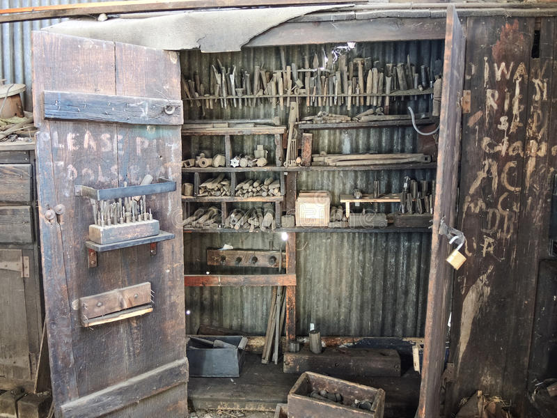 Old railroad machinist tool cabinet. Vintage tools in old railroad roundhouse machine shop royalty free stock images