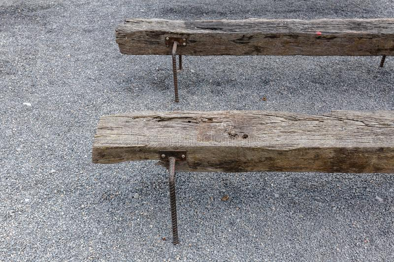 Old railroad sleeper chair recycle from wooden railway stock image