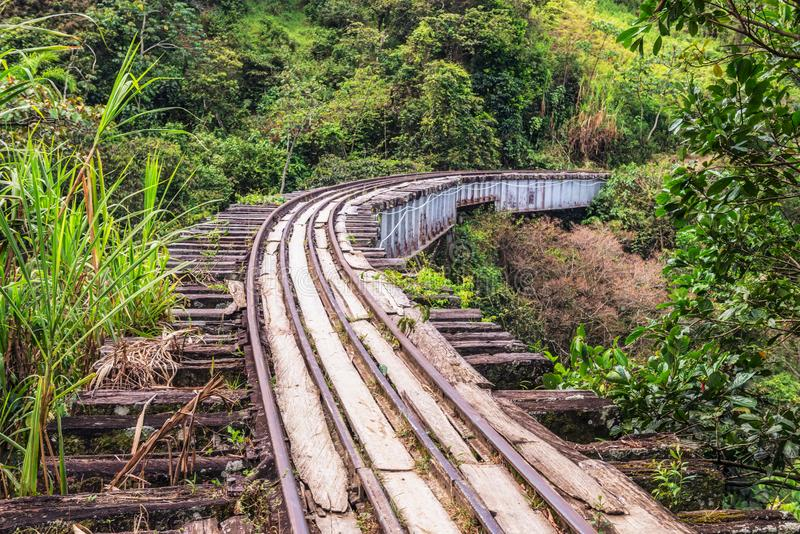 Old railroad track near Medellin, Colombia. Crossing old bridge becomes challenge, it is popular tourists and locals destination for bicycle rides and walking royalty free stock images
