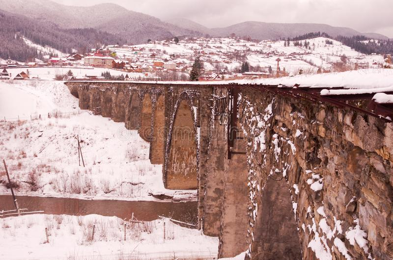 Old railway bridge. Old arch bridge. Winter stock photos