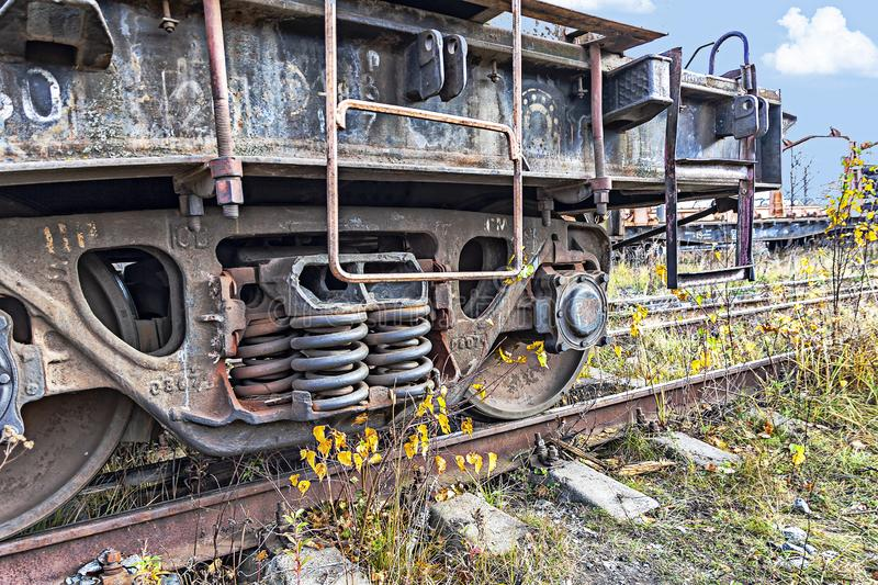 Old railway car wheels on abandoned railway tracks stock photo