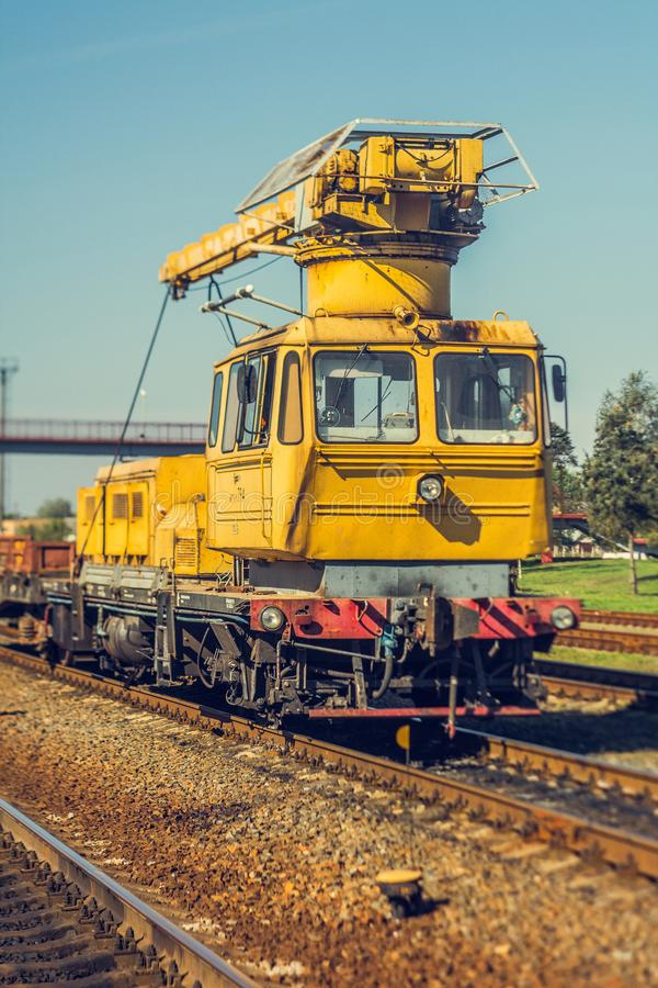 Old railway crane, track repair stock images