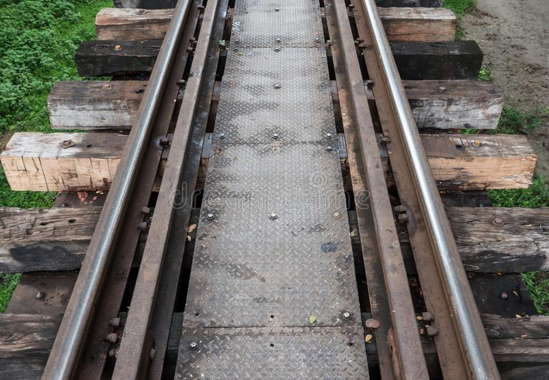 Old railway line with the metal board walkway. royalty free stock photography