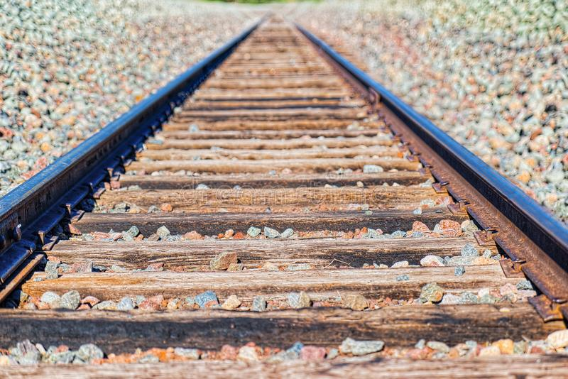 Old railway sleepers and rails in an American town. USA royalty free stock photo