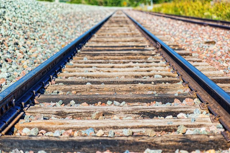 Old railway sleepers and rails in an American town. USA stock photo